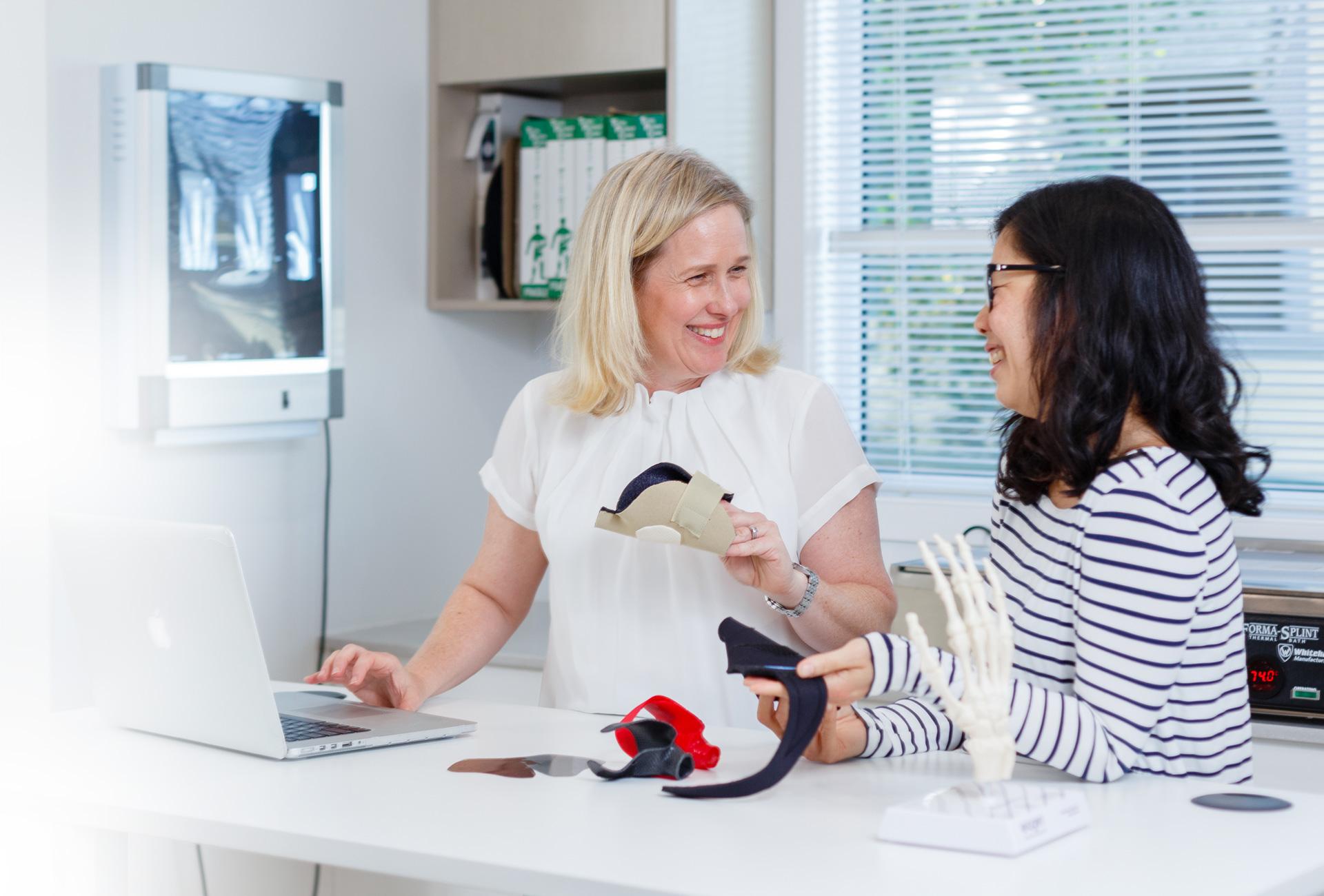HTC Felicity & Vera discussing a patient